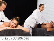 Massage therapist girl is massaging married couple. Стоковое фото, фотограф Яков Филимонов / Фотобанк Лори