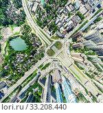 Купить «Aerial city view with crossroads and roads, houses, buildings, parks and parking lots. Sunny summer panoramic image», фото № 33208440, снято 29 марта 2020 г. (c) Александр Маркин / Фотобанк Лори