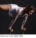 Купить «Beautiful acrobat training on circus stands», фото № 33208784, снято 13 мая 2016 г. (c) Гурьянов Андрей / Фотобанк Лори