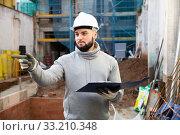 Engineer planning renovation works at building site. Стоковое фото, фотограф Яков Филимонов / Фотобанк Лори