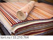 Купить «Stack of multicolored quality rugs at carpet shop», фото № 33210764, снято 22 ноября 2017 г. (c) Яков Филимонов / Фотобанк Лори