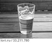 Black and white Beer. Стоковое фото, фотограф Claudio Divizia / PantherMedia / Фотобанк Лори