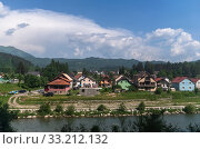 Купить «Rural landscape with mountains and houses in Zabljak Municipality, Montenegro», фото № 33212132, снято 14 июня 2019 г. (c) Володина Ольга / Фотобанк Лори
