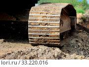 Купить «Caterpillar of heavy construction equipment crawler excavator on the construction site for the expansion of the road. urbanization», фото № 33220016, снято 10 апреля 2020 г. (c) easy Fotostock / Фотобанк Лори