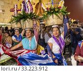 Купить «Oaxaca, Mexico - Dancers as a quinceañera, or a girl's 15th birthday, is celebrated on the streets of Oaxaca.», фото № 33223912, снято 1 февраля 2020 г. (c) age Fotostock / Фотобанк Лори