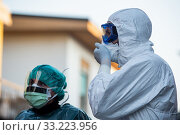 Coronavirus emergency: Nas carabinieri and health workers take Mattia's parents (infected number one) from their home with a bio-containment ambulance... Редакционное фото, фотограф Marfisi/AGF/Nicola Marfisi / age Fotostock / Фотобанк Лори