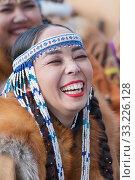 Купить «Portrait expression smiling woman in traditional clothing aborigine people Kamchatka Peninsula. Celebration Koryak national ritual holiday Hololo Day of Seal», фото № 33226128, снято 4 ноября 2018 г. (c) А. А. Пирагис / Фотобанк Лори