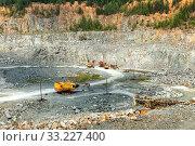 Купить «Coal mining in an open pit», фото № 33227400, снято 25 июля 2019 г. (c) Евгений Ткачёв / Фотобанк Лори