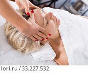 Купить «Mature woman having face massage», фото № 33227532, снято 9 февраля 2017 г. (c) Яков Филимонов / Фотобанк Лори