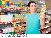 Купить «Woman choosing different oil in supermarket», фото № 33227648, снято 6 июня 2017 г. (c) Яков Филимонов / Фотобанк Лори