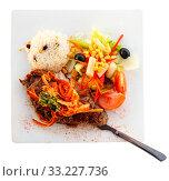 Купить «Veal steak with vegetables and rice», фото № 33227736, снято 9 июля 2020 г. (c) Яков Филимонов / Фотобанк Лори