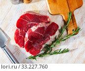 Купить «Raw beef fillet with rosemary», фото № 33227760, снято 31 мая 2020 г. (c) Яков Филимонов / Фотобанк Лори