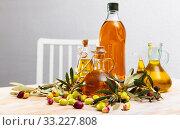 Купить «Olive oil in bottles on wooden table», фото № 33227808, снято 5 июля 2020 г. (c) Яков Филимонов / Фотобанк Лори