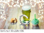 Купить «glass of beer, cupcake, horseshoe and gold coins», фото № 33228136, снято 31 января 2018 г. (c) Syda Productions / Фотобанк Лори