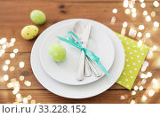 Купить «easter egg in cup holder, plates and cutlery», фото № 33228152, снято 15 марта 2018 г. (c) Syda Productions / Фотобанк Лори