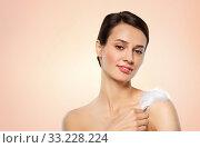 Купить «beautiful woman with feather touching her shoulder», фото № 33228224, снято 30 ноября 2019 г. (c) Syda Productions / Фотобанк Лори