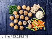 Купить «cheese balls on a black slate tray», фото № 33228848, снято 24 ноября 2019 г. (c) Oksana Zh / Фотобанк Лори