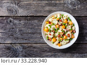 Купить «cauliflower salad with bacon, cheese, green peas», фото № 33228940, снято 28 ноября 2019 г. (c) Oksana Zh / Фотобанк Лори