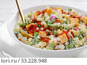 Купить «macaroni salad with green peas, fried bacon», фото № 33228948, снято 28 ноября 2019 г. (c) Oksana Zh / Фотобанк Лори