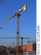 Купить «Berlin, Germany, Baukraene on a construction site at Hildegard-Knef-Platz», фото № 33229640, снято 5 декабря 2019 г. (c) Caro Photoagency / Фотобанк Лори