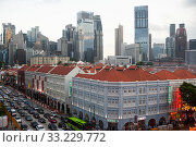 Singapore, Republic of Singapore, city view with Chinatown and the skyline of the business district (2020 год). Стоковое фото, агентство Caro Photoagency / Фотобанк Лори