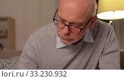 Купить «senior man counting money at home», видеоролик № 33230932, снято 4 января 2020 г. (c) Syda Productions / Фотобанк Лори