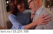 Купить «happy senior couple with gift box at home», видеоролик № 33231100, снято 4 января 2020 г. (c) Syda Productions / Фотобанк Лори