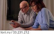 Купить «senior couple with papers and calculator at home», видеоролик № 33231212, снято 4 января 2020 г. (c) Syda Productions / Фотобанк Лори