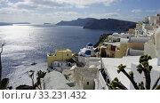 view over small oia village on santorini island. Стоковое фото, фотограф Christian Schnoor / PantherMedia / Фотобанк Лори