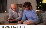 Купить «senior couple with papers and calculator at home», видеоролик № 33231548, снято 4 января 2020 г. (c) Syda Productions / Фотобанк Лори