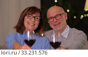 Купить «happy senior couple with glasses of red wine», видеоролик № 33231576, снято 4 января 2020 г. (c) Syda Productions / Фотобанк Лори