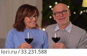 Купить «happy senior couple with glasses of red wine», видеоролик № 33231588, снято 4 января 2020 г. (c) Syda Productions / Фотобанк Лори