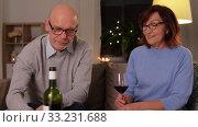 Купить «happy senior couple drinking red wine at home», видеоролик № 33231688, снято 20 января 2020 г. (c) Syda Productions / Фотобанк Лори
