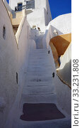 steps and stairs in oia village on santorini island. Стоковое фото, фотограф Christian Schnoor / PantherMedia / Фотобанк Лори