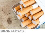 Купить «Cigarettes sticking out from the pack», фото № 33240416, снято 28 февраля 2020 г. (c) PantherMedia / Фотобанк Лори