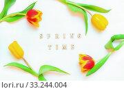 Купить «Lovely spring tulip flowers on wooden backdrop with inscription Spring Time, spring holiday postcard», фото № 33244004, снято 7 марта 2018 г. (c) Зезелина Марина / Фотобанк Лори