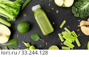 Купить «close up of bottle with green juice and vegetables», видеоролик № 33244128, снято 30 марта 2020 г. (c) Syda Productions / Фотобанк Лори