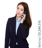 Купить «Businesswoman talk to cellphone», фото № 33244316, снято 8 апреля 2020 г. (c) PantherMedia / Фотобанк Лори