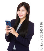 Купить «Businesswoman using mobile phone», фото № 33245116, снято 8 апреля 2020 г. (c) PantherMedia / Фотобанк Лори