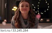 Купить «woman blowing confetti from her hands at home», видеоролик № 33245284, снято 21 января 2020 г. (c) Syda Productions / Фотобанк Лори