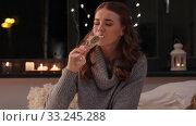 Купить «young woman drinking champagne at home at night», видеоролик № 33245288, снято 17 февраля 2020 г. (c) Syda Productions / Фотобанк Лори