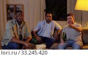 Купить «happy male friends with beer watching tv at home», видеоролик № 33245420, снято 12 января 2020 г. (c) Syda Productions / Фотобанк Лори