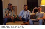 Купить «happy male friends with beer watching tv at home», видеоролик № 33245440, снято 12 января 2020 г. (c) Syda Productions / Фотобанк Лори