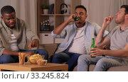Купить «male friends drinking beer with crisps at home», видеоролик № 33245824, снято 13 января 2020 г. (c) Syda Productions / Фотобанк Лори