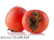 Купить «Red ripe persimmons», фото № 33248624, снято 12 июля 2020 г. (c) PantherMedia / Фотобанк Лори