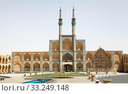 The Amir Chakhmaq Mosque complex facade and square at Yadz,  Iran. The mosque is located in a square with the same name. The prominent structure has a three storey elaborate facade of symmetrical sunken arched alcoves. Стоковое фото, фотограф Maurizio Bersanelli / PantherMedia / Фотобанк Лори