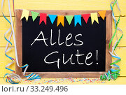 Chalkboard With Party Decoration, Text Alles Gute Means Best Wishes. Стоковое фото, фотограф Nadja Blume / PantherMedia / Фотобанк Лори