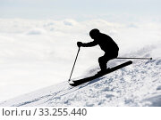 The silhouette of a freestyle skier skiing at the top of a snowy peak of Vitosha mountain covered in clouds. He is participating in an freestyle competition... Стоковое фото, фотограф Zoonar.com/Cylonphoto / age Fotostock / Фотобанк Лори