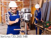 Man is worker behind drilling machine. Стоковое фото, фотограф Яков Филимонов / Фотобанк Лори