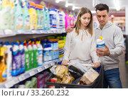 Купить «Couple choosing household detergents», фото № 33260232, снято 7 ноября 2019 г. (c) Яков Филимонов / Фотобанк Лори